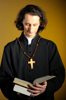 Praying Priest With Wooden Cross Royalty Free Stock Photography