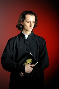 Praying Priest With Wooden Cross Stock Photography