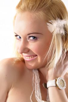Cute Blonde Girl With Mysterious Smile Stock Photo