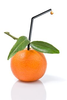 Tangerine With Green Leaves And Straw Royalty Free Stock Photography