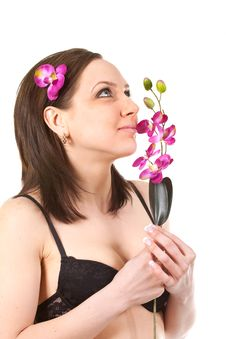 Woman At SPA With Flower Royalty Free Stock Image