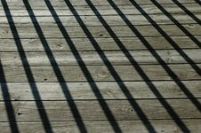 Shadows On Wood Floor Royalty Free Stock Image