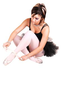 A Young Ballerina Tying Her Ballet Slippers. Stock Image