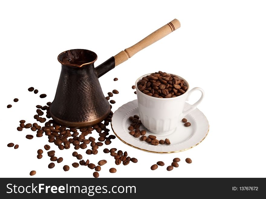 Coffee pot coffee cup and coffe beans
