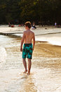 Free Young Boy Is Walking Along The Beach Royalty Free Stock Photography - 13773607