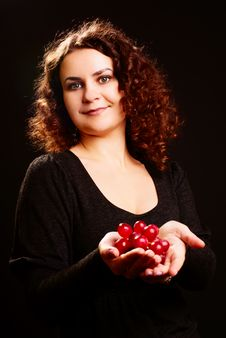 Woman And Grapes. Stock Photo