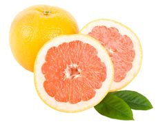 Free Cut Red Grapefruit With Leaves Royalty Free Stock Photography - 13771527