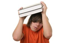 Free Scared Teenager Holds Some Books Over Head Royalty Free Stock Photo - 13772135