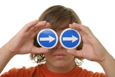 Teenager Holds Before Eyes Signs With Arrows Royalty Free Stock Photography