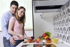 Free Couple Have Fun Preparing Healthy Food In Kitchen Royalty Free Stock Photography - 13772207