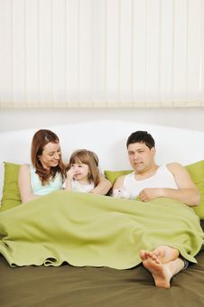 Happy Family Relaxing In Bed Stock Photography