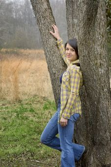 Woman Leaning Against Tree Stock Photography
