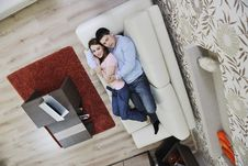Couple Relax At Home On Sofa Royalty Free Stock Image
