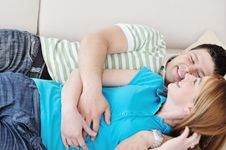 Couple Relax At Home On Sofa Stock Images
