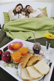 Free Happy Young Family Eat Breakfast In Bed Stock Image - 13772601
