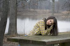 Free Woman Leaning On Picnic Table Stock Photography - 13772622