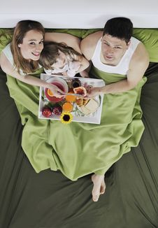 Free Happy Young Family Eat Breakfast In Bed Stock Image - 13772641