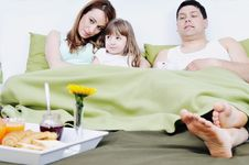 Free Happy Young Family Eat Breakfast In Bed Royalty Free Stock Photo - 13772665