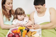 Free Happy Young Family Eat Breakfast In Bed Stock Photo - 13772670