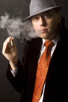 Serious Businessman, Smoking Cigar Royalty Free Stock Photography