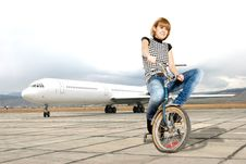 Young Woman On Bike On A Runway Stock Photography