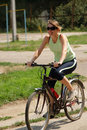 Free Woman Cycling In A Park Royalty Free Stock Image - 13786326