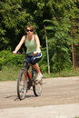 Free Woman Cycling In A Park Royalty Free Stock Photos - 13786338