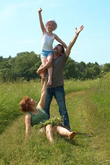 Parents With Daughter On Meadow Royalty Free Stock Image