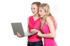 Two Young Attractive Girls With Laptop Royalty Free Stock Images