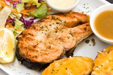 Baked Salmon With Hot Dip And Salad Royalty Free Stock Photo