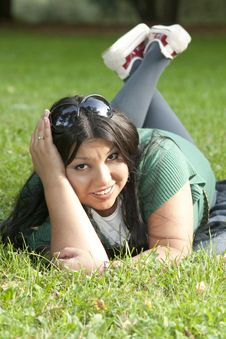 Free Beauty Young Woman Lying On Grass Stock Image - 13780821