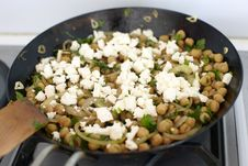 Free Chickpeas And Feta Cheese In A Cast Iron Pan Royalty Free Stock Photography - 13781407