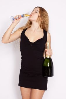 Free Blonde Young Woman Drinking Champagne Royalty Free Stock Photography - 13781687