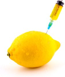 Free Lemon With Syringe Injecting Color Stock Photos - 13782003