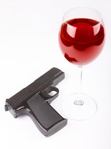 Free Closeup Of Gun And Glass Of Wine Royalty Free Stock Photography - 13782787