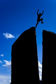 Rock Climber On The Summit. Royalty Free Stock Photography
