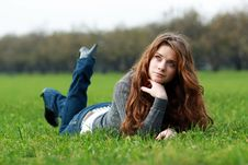 Free Relaxign Girl On Green Grass Royalty Free Stock Photo - 13784275