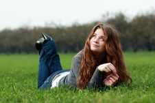 Free Relaxign Girl On Green Grass Stock Photo - 13784280