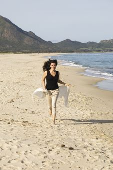 Free Woman Running On The Beach Stock Photos - 13784443