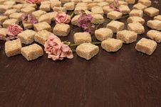 Cane Sugar And Flowers On A Brown Wooden Table Stock Photos