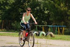Free Woman Cycling In A Park Royalty Free Stock Images - 13786329