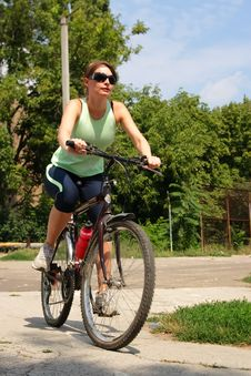 Free Woman Cycling In A Park Stock Photo - 13786340