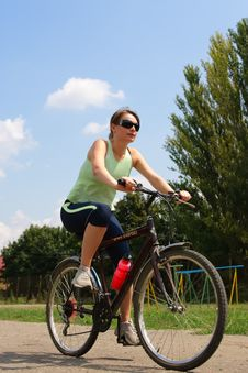 Free Woman Cycling In A Park Royalty Free Stock Image - 13786346
