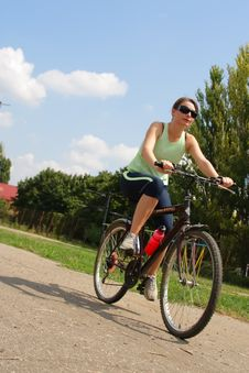 Free Woman Cycling In A Park Stock Photo - 13786350