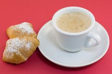 Cup Of Coffee With Croissants On A Red Background Royalty Free Stock Photos
