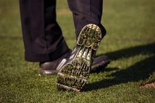 Close-up Of Golfer S Shoe After Hitting Ball Stock Images