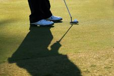 Free Golfer Lines Up His Putt Royalty Free Stock Photo - 13787235