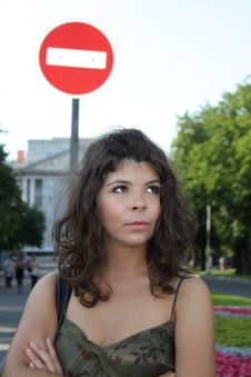 Free Girl Looking Up Near The Road Sign Royalty Free Stock Image - 13788126