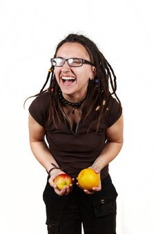 Girl Laught With Apple And Orange Royalty Free Stock Photography
