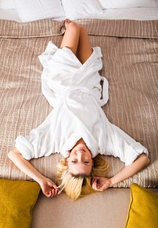 Free Woman Lying On Bed Dressed In  White Robe Stock Images - 13788594